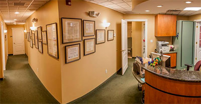 Front desk and hallway at East Lyme Oral and Maxillofacial Surgery.